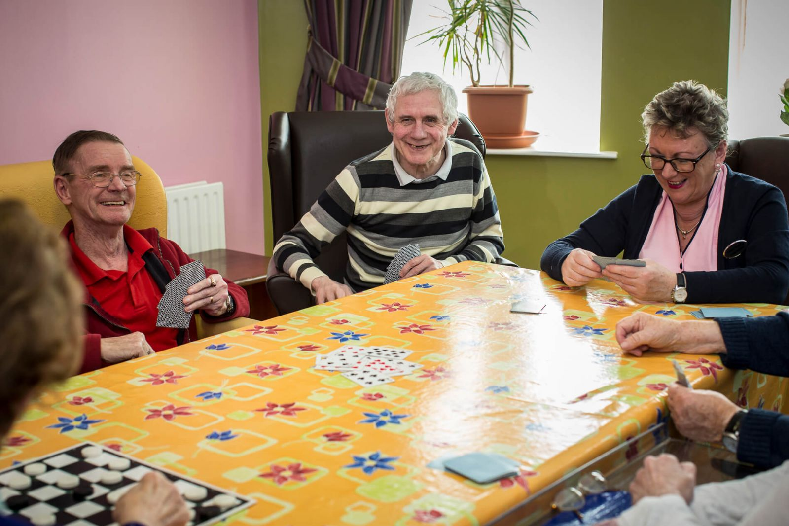 staff playing cards in a recreation room