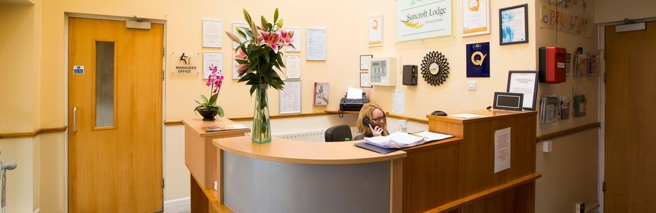 receptionist answering phone in reception area