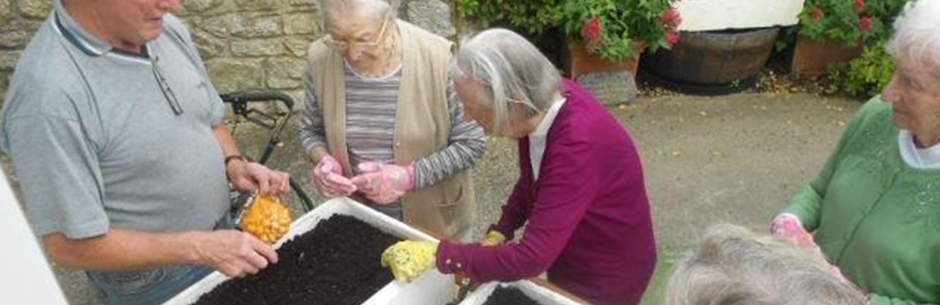 Residents helping with garden maintenance